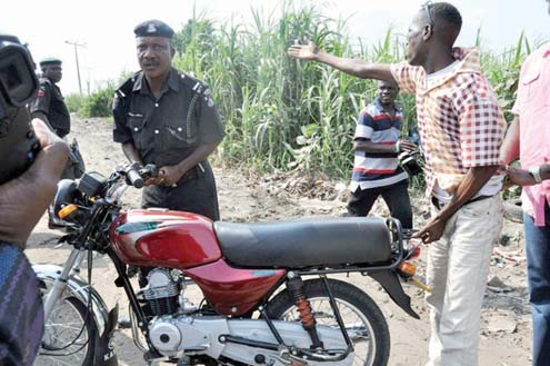 Nigeria Police officer and an Okada rider